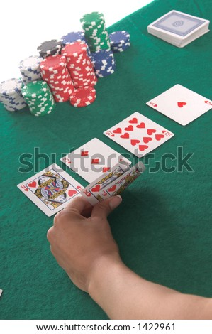 Texas Hold \'Um poker player peels back her cards to reveal a hearts Royal Flush Generic no label card backs from China