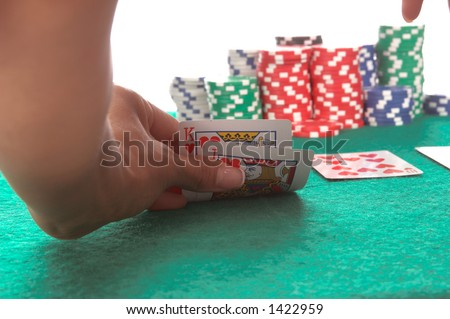 Texas Hold \'Um poker player peels back her cards to reveal a suited King and Jack of hearts that could potentially lead to a  hearts Royal Flush Generic no label card backs from China