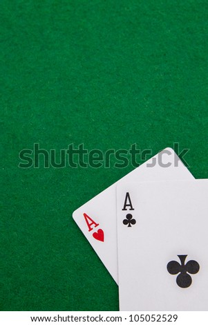 Texas holdem pocket aces on casino table with copy space