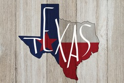 Texas message on a Texas state flag with the state map over weathered wood