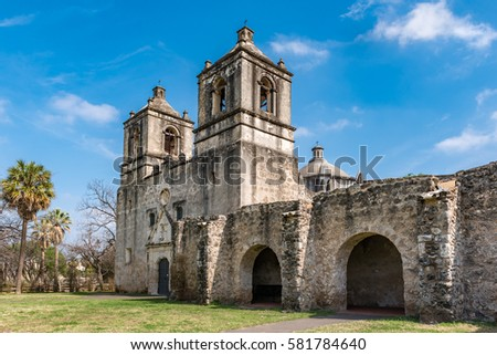 Shutterstock Texas Mission Concepcion side view with arches along the fortress walls church dome in the background