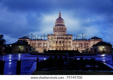 Texas State Capitol building in Austin on a rainy evening