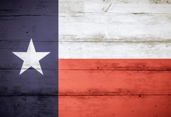 Texas State Flag on barn wood, with faded colors