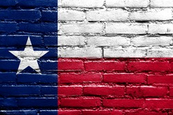 Texas State Flag painted on brick wall