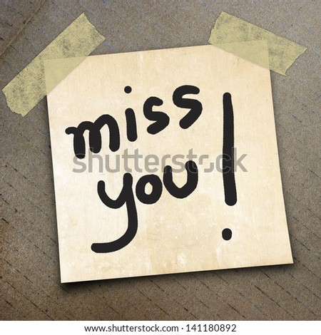 texr miss you on short note paper on the packing paper box texture background