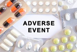 Text ADVERSE EVENT on a white background. There are different medicines around.