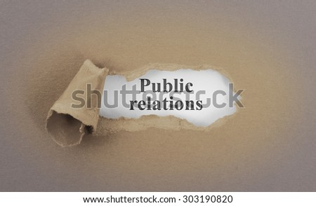 Text appearing behind torn brown envelop - Public relations