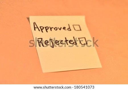 Text approved rejected on the short note texture background