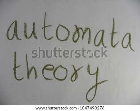Text automata theory hand written by green oil pastel on white color paper