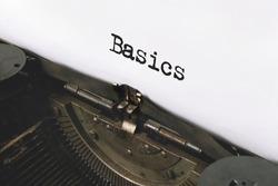 Text Back to Basics typed on retro typewriter