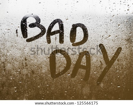 "Text ""BAD DAY"" written in a crystal with many drops."