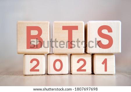 Text - BTS 2021 on wooden cubes, on wooden background Stock fotó ©