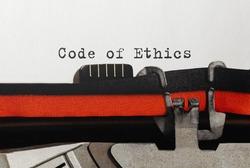 Text Code of Ethics typed on retro typewriter