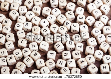 Text concept macro: Letter dices lying in chaos on table