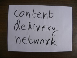 Text content delivery network hand written by black color oil pastel on paper