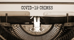 Text 'Covid19 crimes' typed on retro typewriter. Business and post-pandemic covid-19 concept.