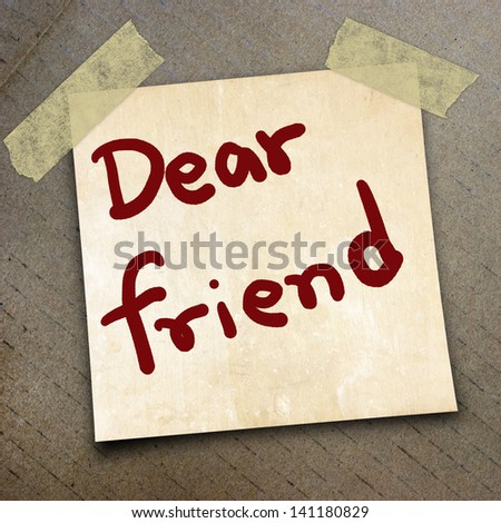 text dear friend on short note paper on the packing paper box texture background