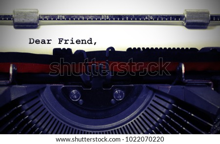 Text Dear Friend written with the old typewriter on white page #1022070220