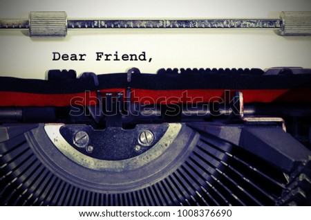 Text Dear Friend written with the typewriter on white sheet #1008376690