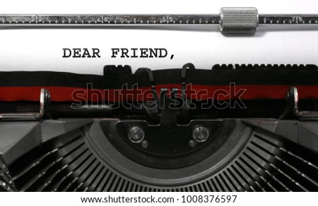 Text Dear Friend written with the vintage typewriter on white sheet #1008376597