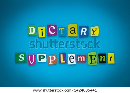 Text - Dietary Supplement on blue background from colorful letters. Card with an inscription. Headline, caption, heading on banner. Letter on bright illustration. Concept of diet nutrition, food. #1424885441