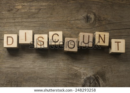 text discount on a wooden background