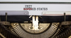 Text 'divided states' corrected to 'united states' typed on retro typewriter. Business concept. Beautiful background.