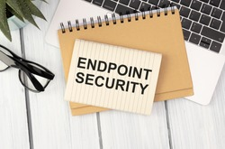 Text ENDPOINT SECURITY on brown paper notepad in businessman hands in office. Business concept
