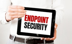 Text ENDPOINT SECURITY on tablet display in businessman hands on the white bakcground. Business concept