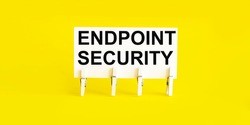 text Endpoint Security on the white short note paper yellow background
