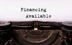 text Financing available typed words on a vintage typewriter. Business startup concept.