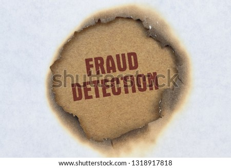 Text Fraud Detection written in red on burnt paper