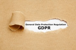 Text General Data Protection Regulation GDPR appearing behind ripped brown paper.