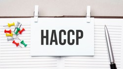 text haccp on stickers on the diary with office tools