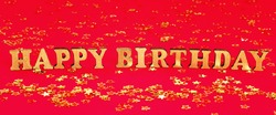 Text Happy birthday laid out of gold letters on a beautiful background. Golden stars confetti. Banner