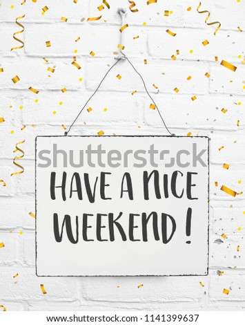 Text have a nice weekend white sign banner board with golden confetti on white brick background