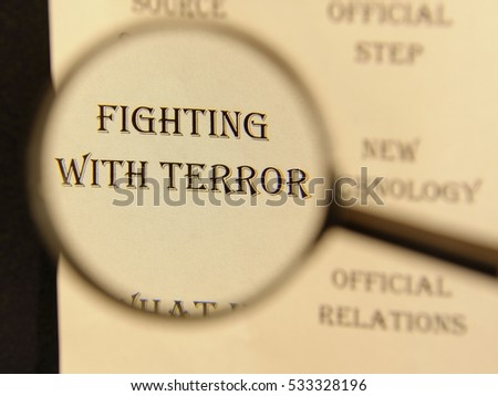 """Text - headline of newspaper article - at loupe. Words """"Fighting with terror"""" #533328196"""