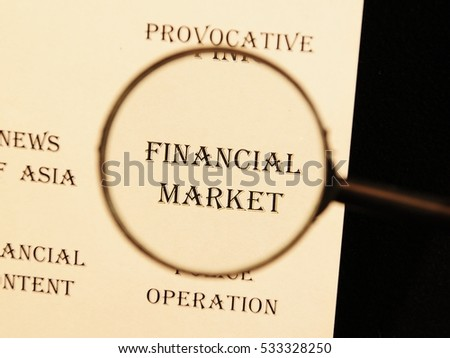 """Text - headline of newspaper article - at loupe. Words """"Financial market"""" #533328250"""