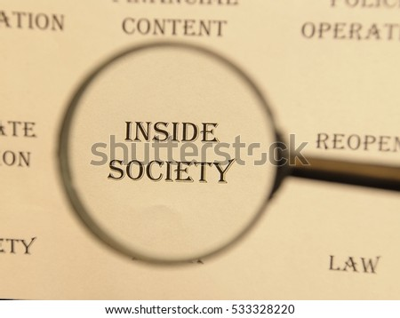 """Text - headline of newspaper article - at loupe. Words """"Inside society"""" #533328220"""