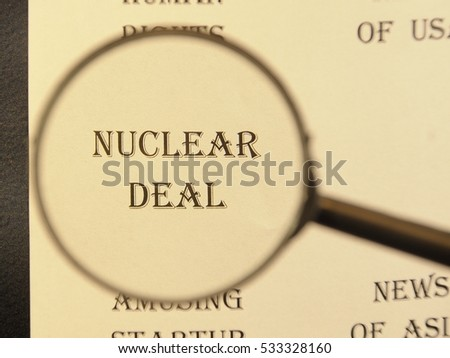 """Text - headline of newspaper article - at loupe. Words """"Nuclear deal"""" #533328160"""
