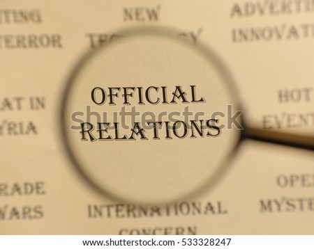 """Text - headline of newspaper article - at loupe. Words """"Official relations"""" #533328247"""