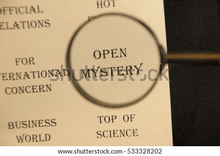 """Text - headline of newspaper article - at loupe. Words """"Open mystery"""" #533328202"""