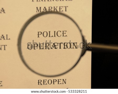 """Text - headline of newspaper article - at loupe. Words """"Police operation"""" #533328211"""