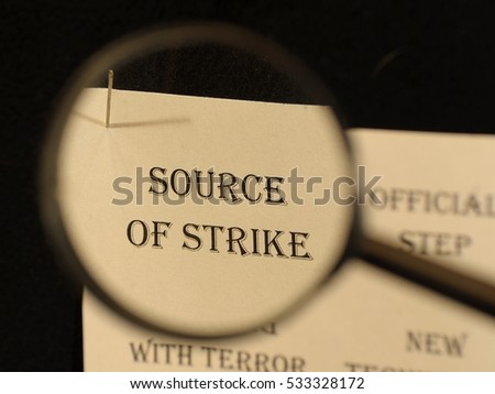 """Text - headline of newspaper article - at loupe. Words """"Source of strike"""" #533328172"""