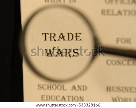 """Text - headline of newspaper article - at loupe. Words """"TRADE  WARS"""" #533328166"""