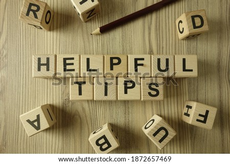 Text helpful tips from wooden blocks, advice or information concept Сток-фото ©