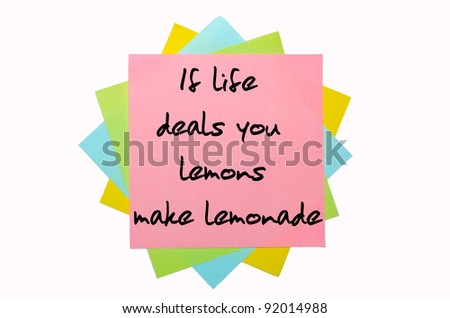 """text """" If life deals you lemons, make lemonade """" written by hand font on bunch of colored sticky notes"""