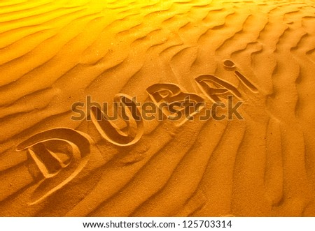 Text in desert sand Dubai