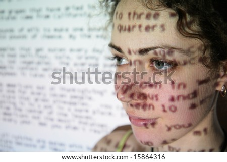 text is projected on face of woman