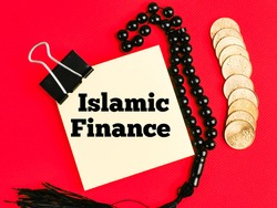 Text Islamic Finance on paper note with prayer beads and coins isolated on red background. Islamic economy concept.